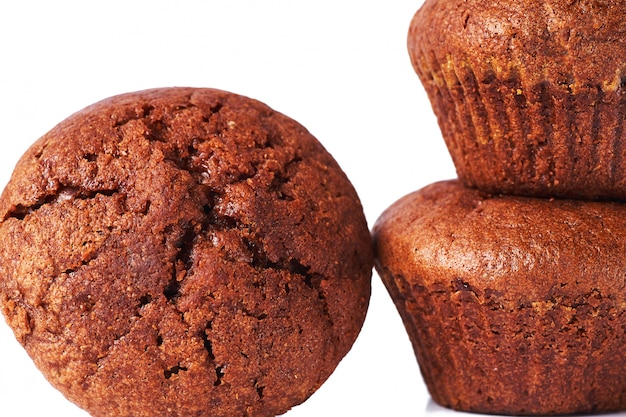 A few dark chocolate dough muffin on isolated on white background.