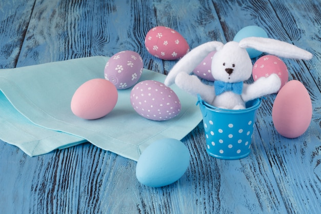 Few easter eggs on blue wooden table