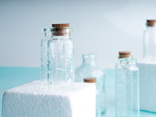 Few transparent bottles, water sprays