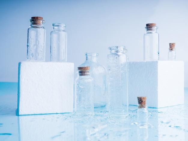 Few transparent bottles, water sprays.