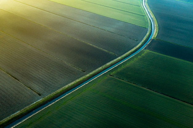 Fields viewed by a drone in the sunset