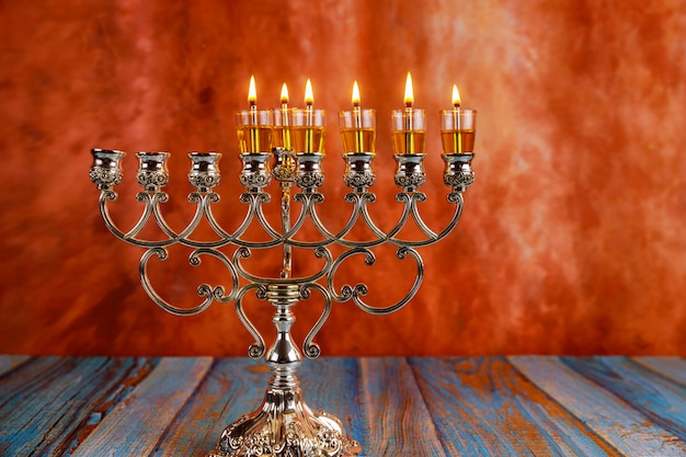 Fifth day hanukkah candles are burning on light of the jewish holiday