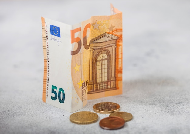 Fifty euro banknote with coins