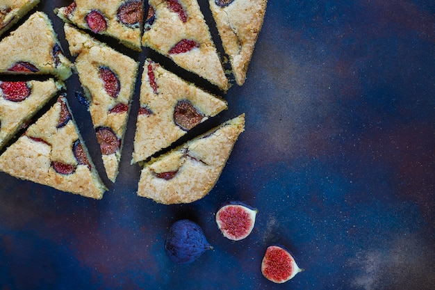 Fig cake with fresh figs on dark