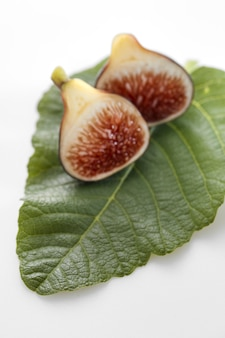 Fig fruits with leaves on white