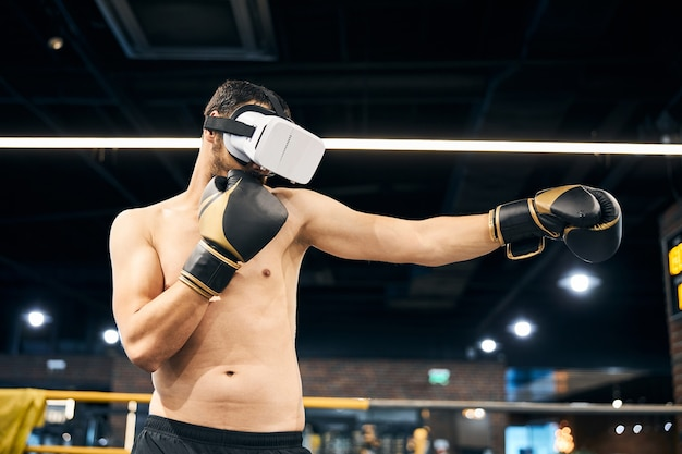 Fighter exercising boxing moves while wearing a virtual reality equipment