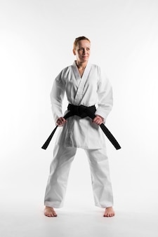 Fighter holding black belt full shot