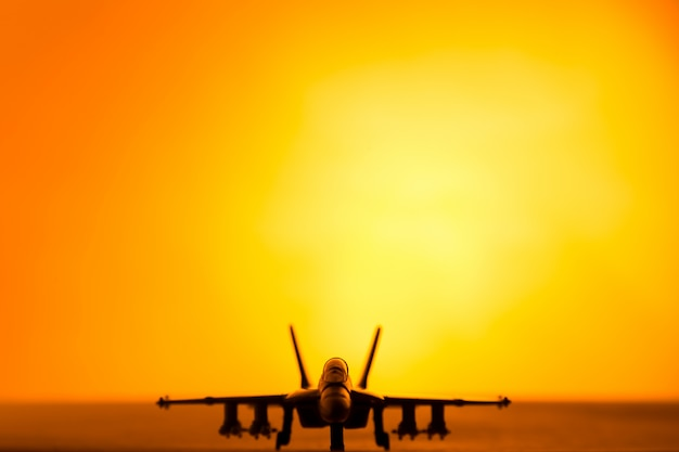 Fighter jet scale model in a scenery sunset