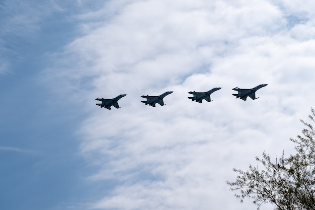 Fighter jets in the blue sky and clouds rehearsal of victory parade airshow