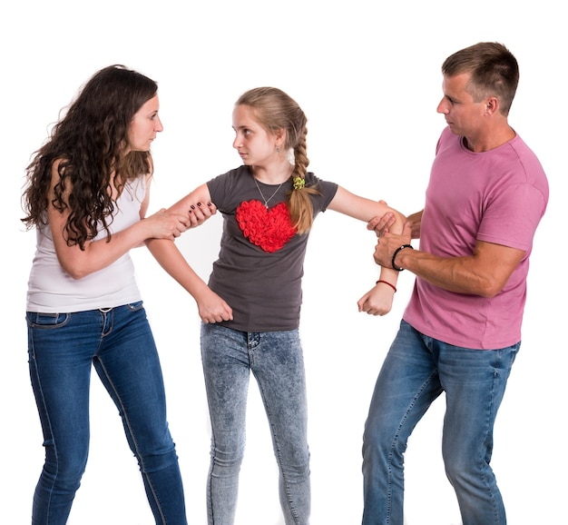 Fighting parents and daughter on a white wall. divorce concept