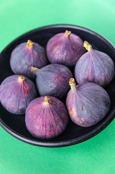 Figs fruit fresh ready to eat meal snack on the table copy space food background rustic top view