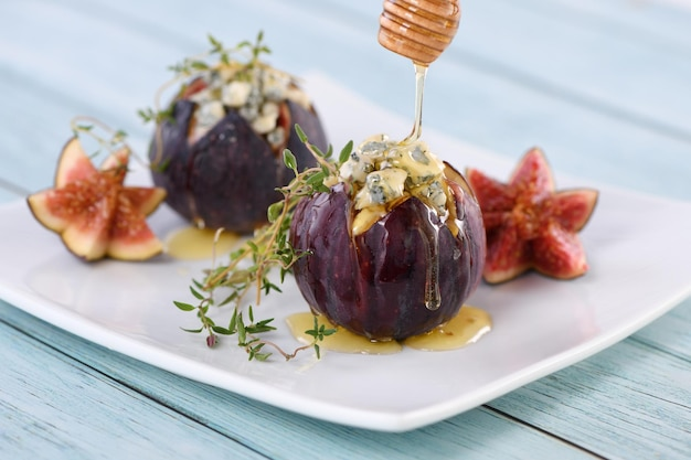 Figs stuffed with blue cheese and thyme, seasoned with honey