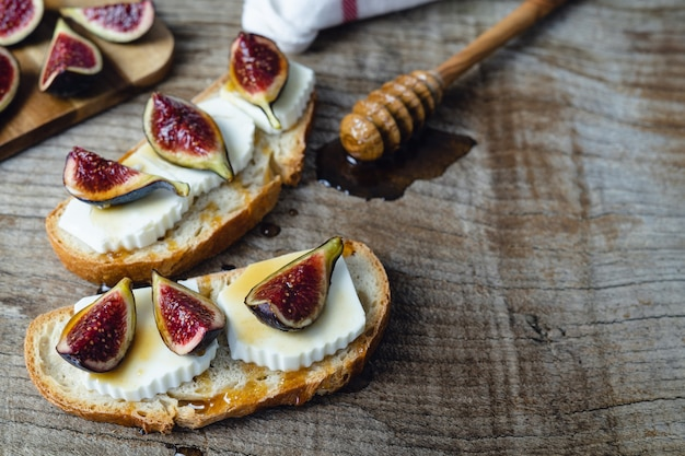 Figs with fresh cheese on toast copy space.