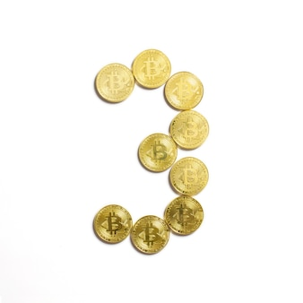 The figure of 3 laid out of bitcoin coins and isolated on white background