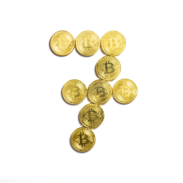 The figure of 7 laid out of bitcoin coins and isolated on white background