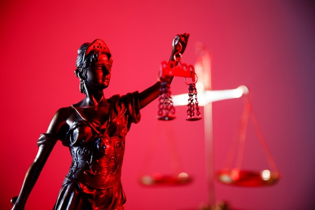 Figure of lady justice in neon.