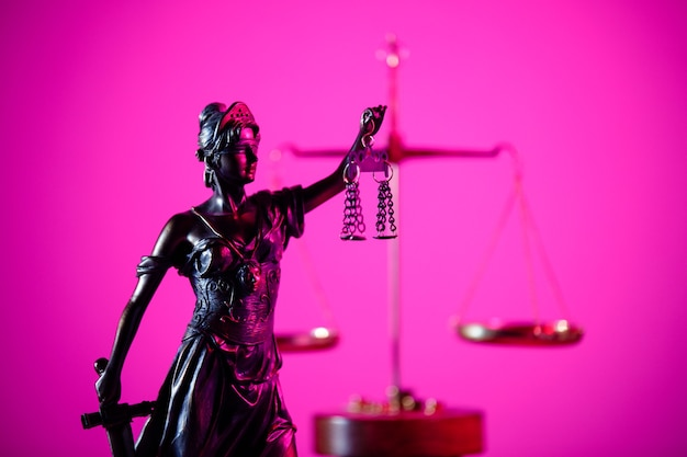 Figure of lady justice in notary office in purple neon.