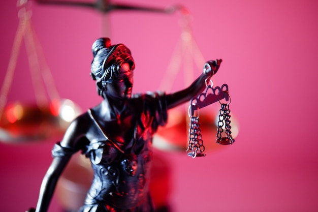 Figure of lady justice in notary office.