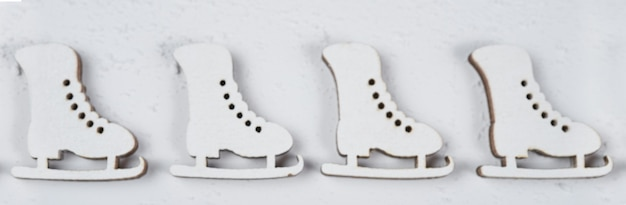 Figure skates are suspended against the background .not in sharpness, in blur.