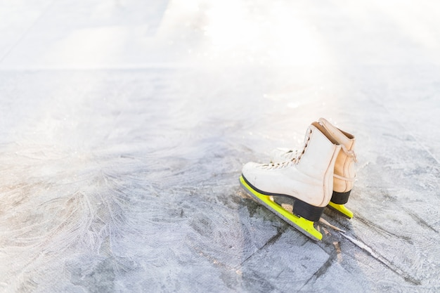 Figure skates on cracked ice
