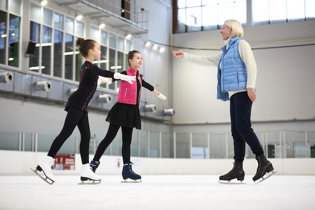 Figure skating coach with children