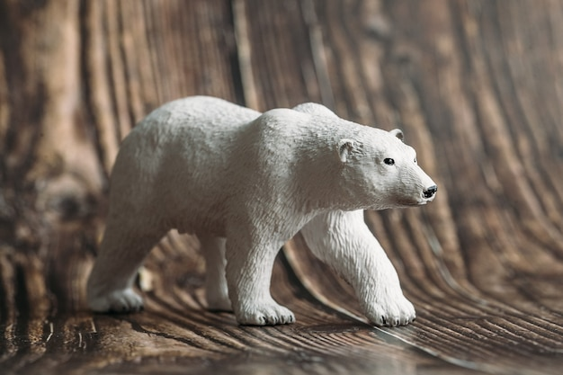 Figure of a toy polar bear on a wooden