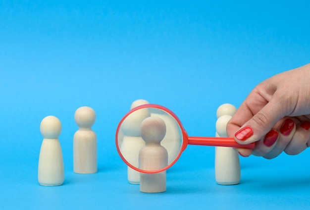 Figures of men stand and a magnifying glass. recruitment concept, search for talented, career growth