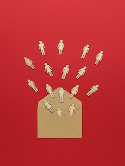 Figures of people flying out of an open postal envelope on a red background.