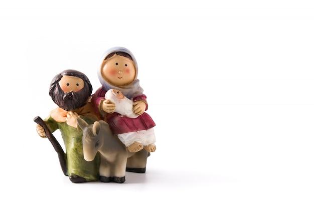 白で隔離されるキリスト降誕のシーンを表す図。イエス、マリア、ホセ。コピースペース