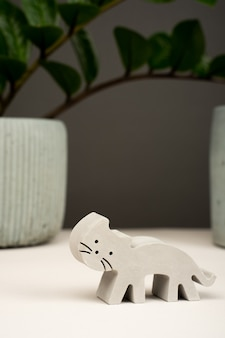 Figurine toy animal handmade concrete and plaster cat for playing with children and minimalistic decor and home decoration.