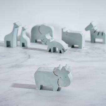 Figurine toy animal handmade concrete and plaster cow for playing with children and minimalistic