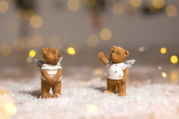 Figurines of bears with angel wings
