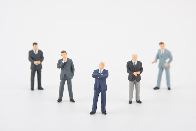 Figurines of white collar business team. five persons