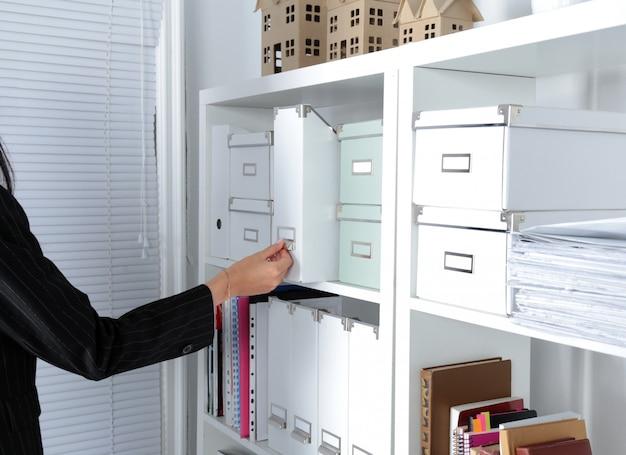 File folders, standing on shelves