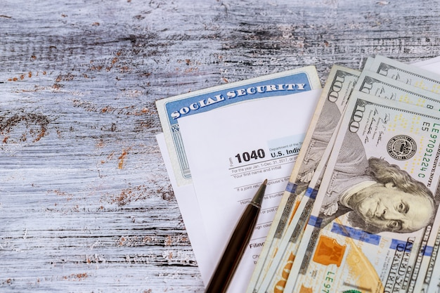 Filing federal taxes for a refund tax form currency and wooden