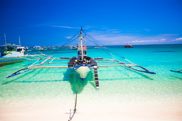 Filipino boat in the turquoise sea, boracay, philippines