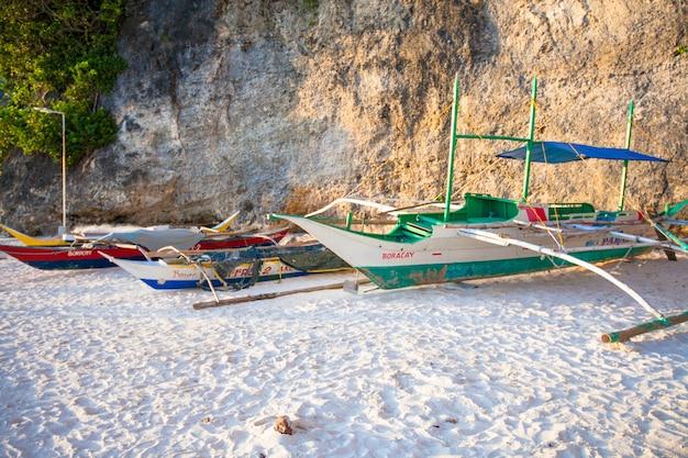 Filipino boat on white sandy beach in boracay, philippines