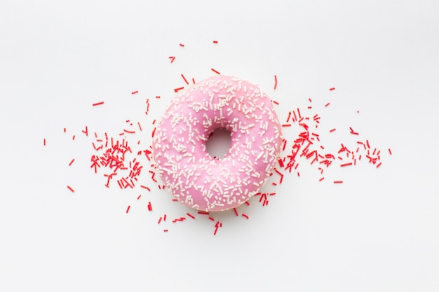 Filled donut on plain background