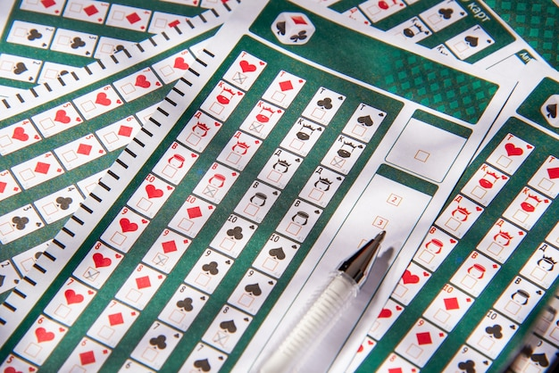 Filled lottery tickets and pencil, close-up, playing lottery or bingo have a chance to win the jackpot