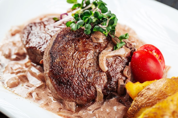 Fillet mignon steaks mushroom sauce with potatoes