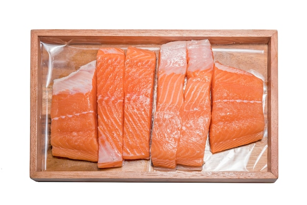 Fillet of salmon on wood plate isolated on white