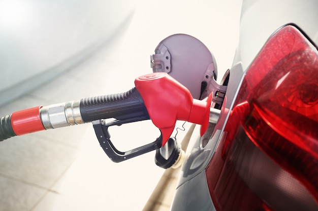 Filling car with gasoline at petrol stations
