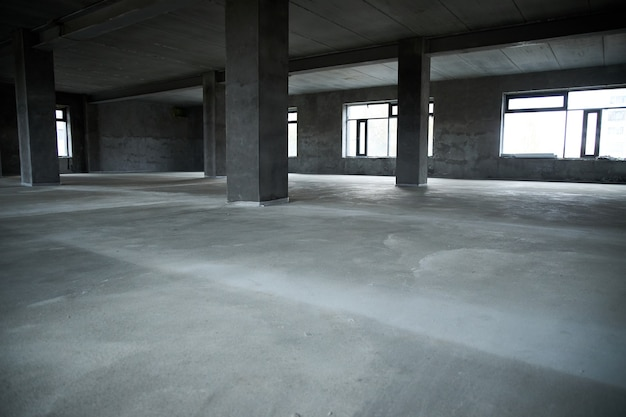 Filling the floor with concrete, screed and leveling the floor. smooth floors made of a mixture of cement, industrial concreting