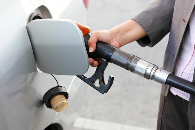 Filling gasoline at gas station