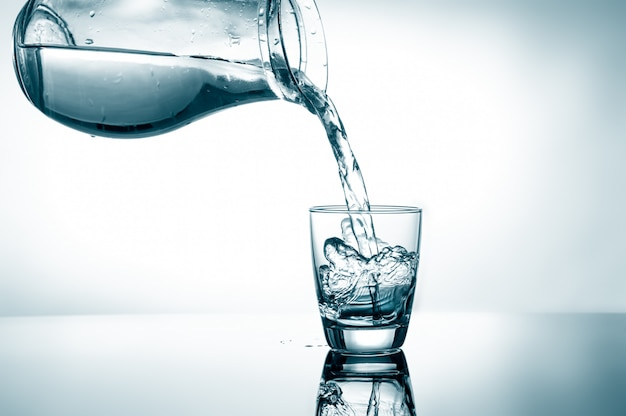 Filling in glass of water