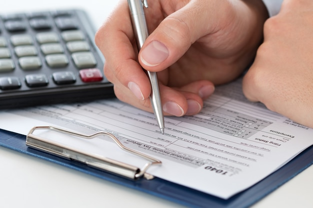 Filling individual income tax return form, home finances or economy concept