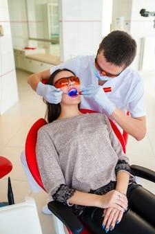Filling teeth in a woman in dentistry