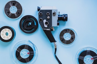 Film camera and filmstrips on blue
