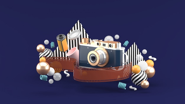 Film camera surrounded by film and colorful balls on a  purple space