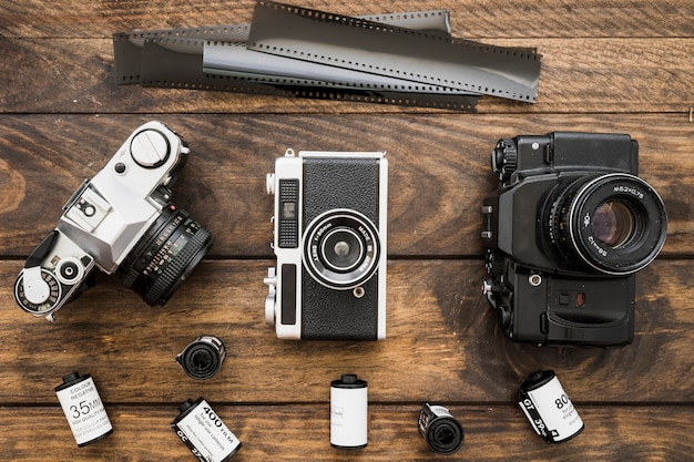 Film and cameras on lumber tabletop